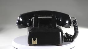 Old style telephone. Old style black telephone on a turntable roating stock video footage