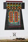 Old-style Tibetan window and sleeping dog Stock Photos