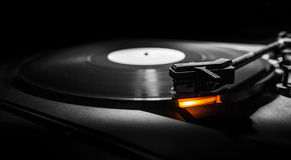Old style turntable with needle. B&w and orange light Stock Photos