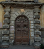 Old style vintage wooden door of ancient mansion is closed Stock Photos