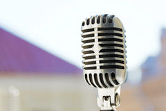 Old style vocal microphone. Retro classic design. Tinted photo.  Stock Image