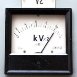 Old style voltmeter gauge Stock Photo