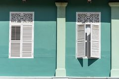 Old style white windows with Green wall stock image