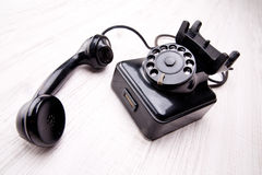 Black old fashioned rotary dial telephone Royalty Free Stock Photo