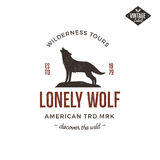 Old style wilderness label with wolf and typography elements. Vintage letterpress effect print. Prints of howling wolf Stock Image