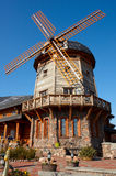 Old style windmill. On clear blue sky background Stock Photos