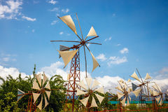 Old-style windmills used as touristic attraction on Lasithi Plateau Stock Photo