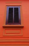 Old style window. And orange wall Stock Image