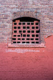 Old style window on red bricks wall Royalty Free Stock Images