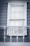 Old style window. Old style white window on a blue wall Royalty Free Stock Image