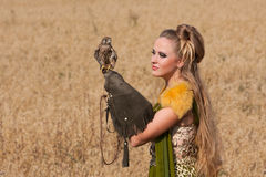 Old style Woman with hawk on hand Stock Photography