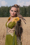 Old style Woman with hawk on hand Stock Photo