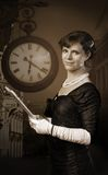 Old style woman with paper. Old style woman with clock in background hold paper Royalty Free Stock Photography
