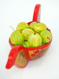 Old-Style Wooden Bowl With Gooseberries. Old-Style Wooden Bowl Filled With Juicy Fresh Ripe Green Gooseberries Stock Photo