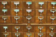 An old style wooden cabinet of library card  or file catalog ind Stock Photography