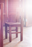 Old style wooden chair in coffee shop with vintage filter Royalty Free Stock Photos