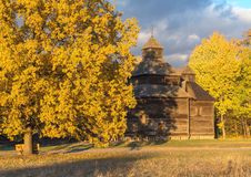 Old-style wooden church in atumn (Ukraine) Stock Image