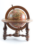 Old style wooden globe on isolated background. Old wooden globe on wooden stand showing north america on white isolated background Royalty Free Stock Photo