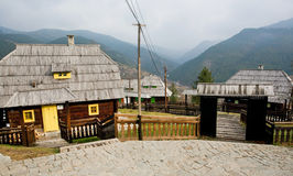 Old style wooden houses in mountains Stock Image