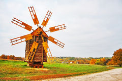 Old style wooden windmill. Beautiful rural autumn Landscape Royalty Free Stock Photography