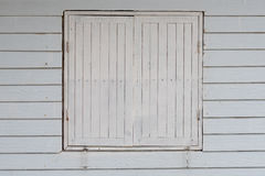 Old style wooden windows. Old wooden windows on slat wooden panel with white paint Stock Image