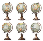 Old style world globes. Collection of old style world globes isolated on white background. Showing all continents Royalty Free Stock Photography