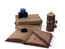 Old style writing set  with a candle. Ready for writing  on a white background Stock Images