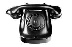 Old-styled black telephon with rotary dial isolated Stock Photo