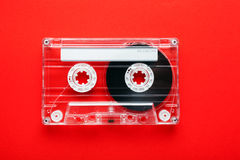 An old styled cassette. Audio tape cassette on red background stock photo