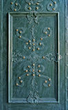 Old-styled decorated metal door. Background Stock Photography