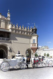 Old-styled horse carriage on main market square in Cracow, Poland.  royalty free stock photos