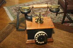 Old styled telephone stock image