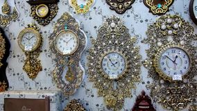 Old styled wall clocks stock video footage