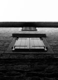 Old styled windows in B&W. Old styled windows on two floors, photographed in B&W Stock Photography