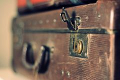 Old stylish brown suitcase with retro effect Stock Images