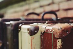 Old stylish brown suitcases with retro effect Stock Images