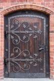 Old stylish door in Polish cathedlak Stock Photos