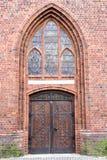Old stylish door in Polish cathedlak Royalty Free Stock Image