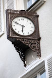 Old stylish external clock. Vintage Stock Images