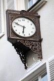Old stylish external clock. Vintage stock images