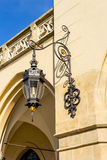 Old stylish lamp at the Cloth Hall in Krakow Stock Photo