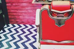 Old Stylish Vintage Barber Chair background close up.  royalty free stock images