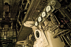 Old submarine interior. The interior of an old submarine, complicated machinery depicted in sepia Royalty Free Stock Photos