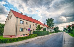 Old suburban district of Koszalin Poland. Old suburban area of Koszalin, northern Poland town. HDR image with graphic ominous clouds. Vanishing point perspective Royalty Free Stock Images