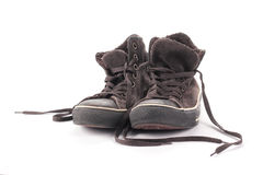 Old suede sneakers. On a white background Royalty Free Stock Photography