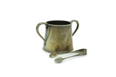Old sugar bowl. Sugar bowl in silver plated metal and its sugar clip Stock Photos