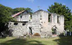 Old sugar mill industry bequia svg. Rebuilt old sugar mill from the 1700s in industry bay bequia st. vincent and the grenadines island nation in the caribbean Stock Photo