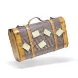 Old suitcase. Classic suitcase in flying action with post it Stock Photo