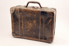 Old suitcase. Old brown suitcase for travel, white background royalty free stock image