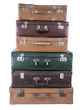 Old suitcase. A stack of older assorted luggage pieces isolated on white Royalty Free Stock Images